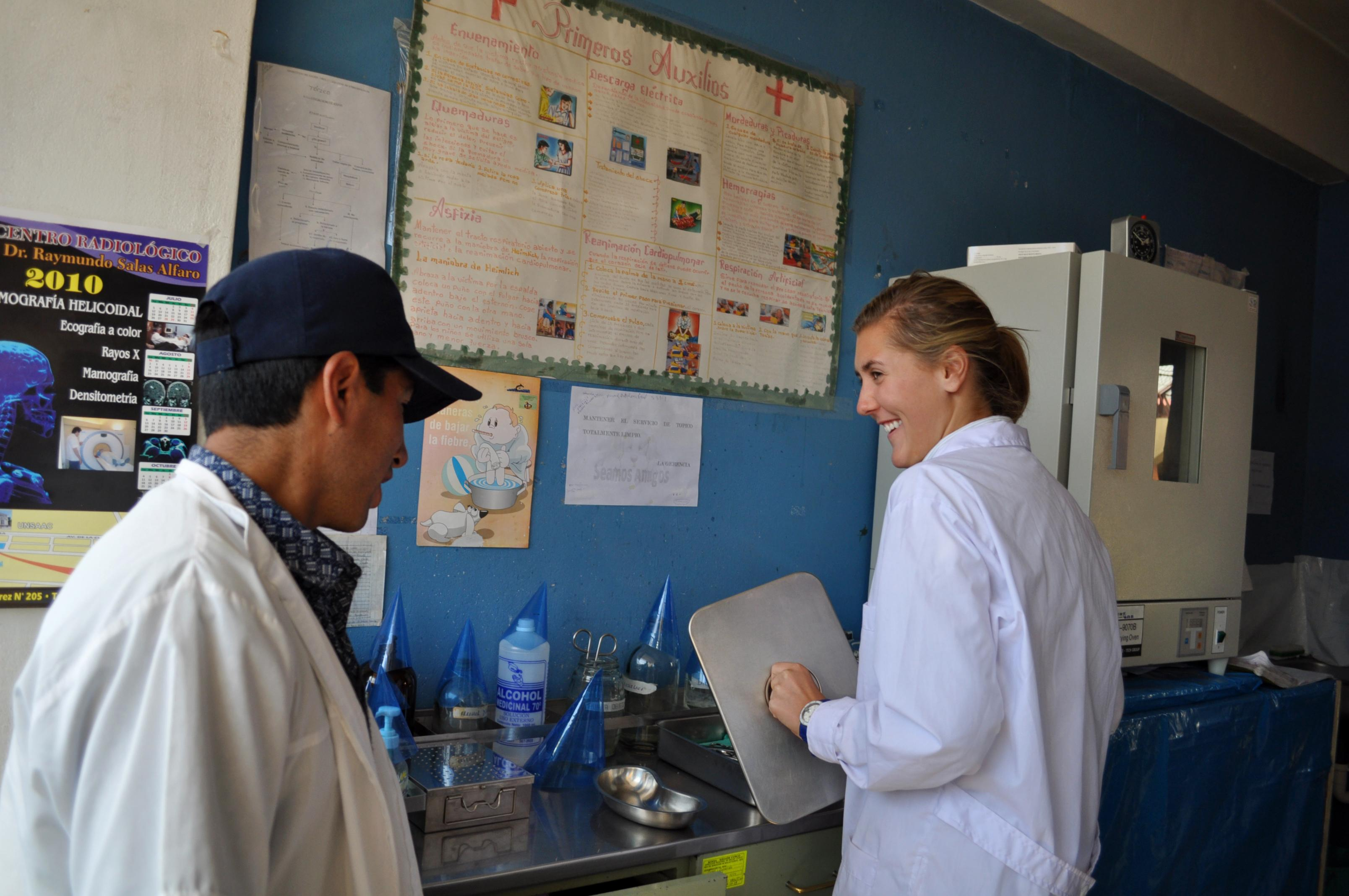 A local doctor and Projects Abroad intern are seen sharing a joke during her medicine and nursing internship in Peru.